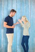 Young couple having an argument against wooden planks