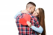 Man kissing beautiful woman with heart card
