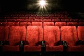 image of drama  - Empty comfortable red seats with numbers in cinema - JPG