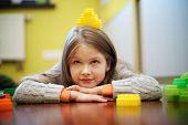 Happy beautiful girl plays with blocks