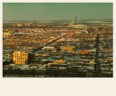 Panorama of Montreal during winter from the mont royal mountain.  Cross processed to look like and aged pictures.