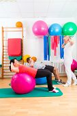 stock photo of physical therapist  - Patients at the physiotherapy doing physical exercises with therapist - JPG