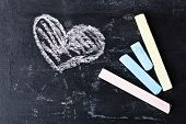 love heart symbol and chalk on a blackboard