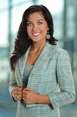 Portrait of beautiful young businesswoman smiling inside office building
