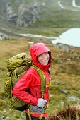 picture of rain  - Hiker woman hiking with backpack in rain on trek living healthy active lifestyle - JPG