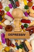 stamp on colorful tablets, symbolic photo for depression, therapy and psychotropic drugs