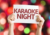 Karaoke Night card with colorful background with defocused lights