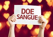 Give Blood (in Portuguese) card with heart bokeh background