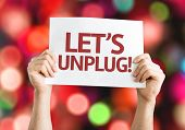 Let's Unplug! card with colorful background with defocused lights