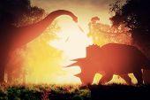 Dinosaurs in Prehistoric Jungle in the Sunset Sunrise