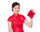 Chinese woman hold with Fai Chun, word meaning is good luck