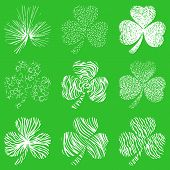 Vector set of scribbled hand drawn  clovers