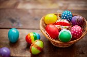 Creative Easter symbols of various colors in basket