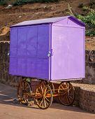 Street vendor (hawker) purple cart, India