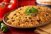 stock photo of cilantro  - A plate of delicious authentic Mexican Rice with black beans corn garlic and cilantro - JPG