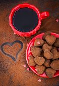 Heart Shaped Chocolate Truffles And Cup Of Coffee
