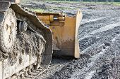 picture of excavator  - closeup of tracked loader excavator at stony quarry on a building site - JPG