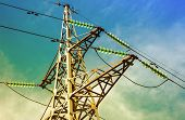 stock photo of voltage  - High voltage electric tower against the blue sky - JPG