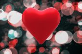 Red heart against digitally generated twinkling light design