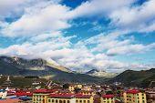 tibetan residence and skyline near mountain