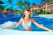 Woman relaxing in jacuzzi. Vacation at caribbean resort.