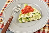 Omelet with broccoli and tomato sauce