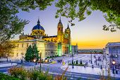 Madrid, Spain at La Almudena Cathedral and the Royal Palace.
