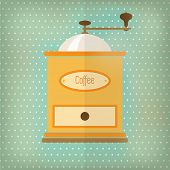 Retro style coffee grinder, with drawer and label, over faded turquoise polka dot background.
