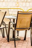 White And Black Restaurant Chairs Outdoor. Open Cafe.
