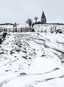 pic of greater  - Tracks in the snow going up the hill towards Pikehead in the Medlock valley greater Manchester - JPG