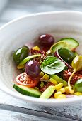 Meiditerranean salad with olives and caper berries