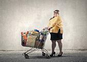 Chubby woman doing shopping