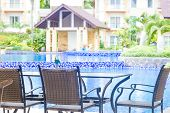 table and chairs in outdoor cafe, small restaurant at hotel poolside, summer vacations, meal time