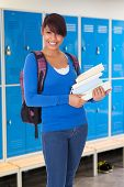 Portrait Of Beautiful Student Girl With Books
