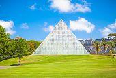 SYDNEY,AUSTRALIA-JAN 6, 2015:Pyramid with glass and steel facadeon Jan 6 2015 in Palm Cove, Royal Botanic Gardens in Sydney, Australia.