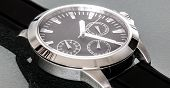 picture of reflection  - Silver colored stainless steel watch for men on a reflective background - JPG