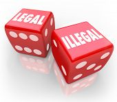 picture of dice  - Legal and Illegal words on two red dice to illustrate taking your chances on law and regulation issues - JPG