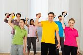 Group Of People Lifting Kettle Bell Weights