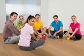 Multiethnic Friends Relaxing In Gym