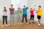Fitness Instructor With People Exercising