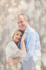 stock photo of male pattern baldness  - Happy mature couple hugging and smiling against light glowing dots design pattern - JPG
