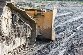 picture of power-shovel  - closeup of tracked loader excavator at stony quarry on a building site - JPG