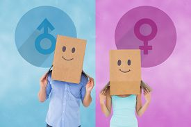 stock photo of emoticon  - Couple wearing emoticon face boxes on their heads against female gender symbol - JPG