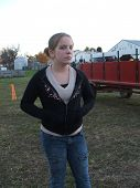 picture of hayride  - young girl waiting to go on a hayride for halloween - JPG