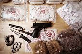 foto of smuggling  - Drug packages raw opium drug dozens and weapons seized by police - JPG