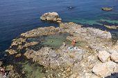 picture of sevastopol  - Vacationers sunbathing on the rocky coast of Sevastopol - JPG