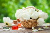 image of bunch roses  - Wicker basket with roses bunch and bottles of essential oil - JPG