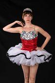 stock photo of slender  - Pretty slender brunette in a red and white tutu - JPG