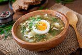 stock photo of sorrel  - Green soup of sorrel in wooden  bowl - JPG
