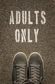 stock photo of adults only  - Adults only stencil print on the asphalt road - JPG